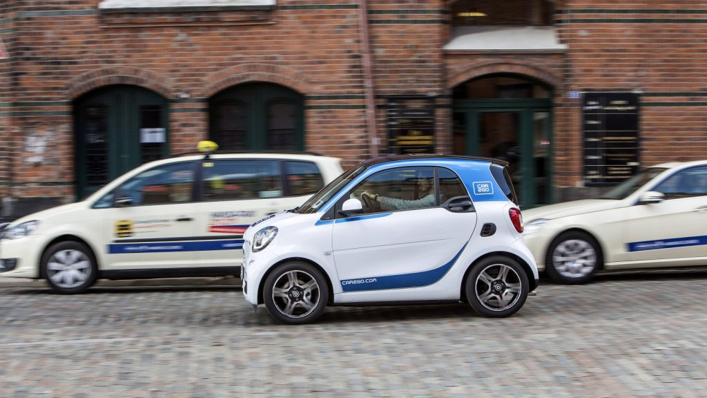 A Car2Go smart fortwo drives through Berlin