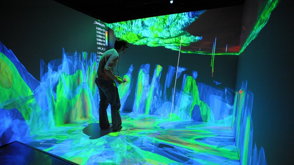 Idaho National Laboratory researchers view a subsurface model in the Computer-Assisted Virtual Environment at the Center for Advanced Energy Studies
